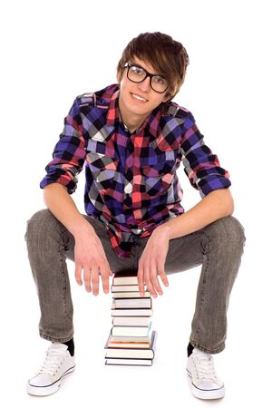 Student sitting on stack of books photo