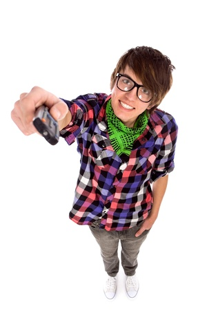 Young man holding remote control photo