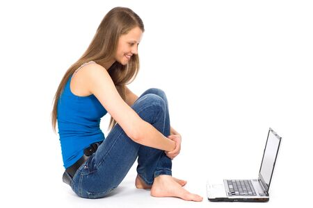 Girl sitting with laptop photo