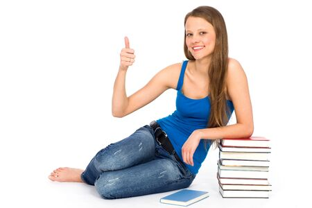 Young woman sitting with books photo