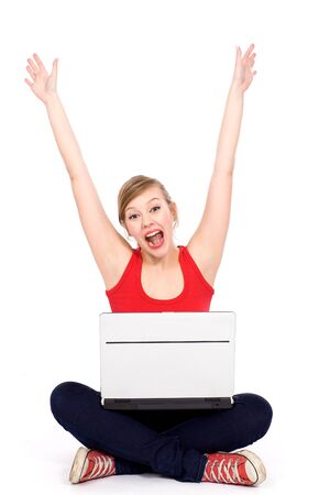 Excited woman with laptop Stock Photo - 9362753