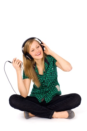 Girl sitting with mp3 player photo