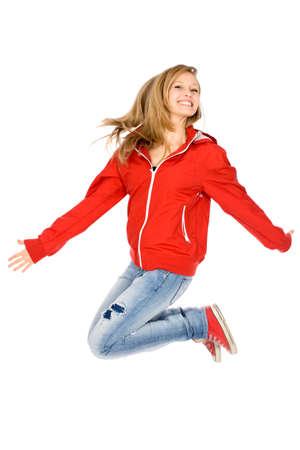 Young woman jumping photo