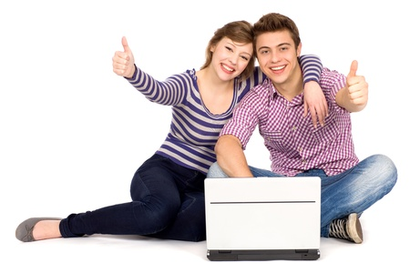 Couple with thumbs up using laptop photo