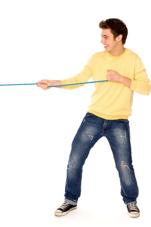 Young man pulling a rope Stock Photo