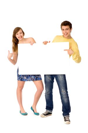 Young couple holding blank paper photo