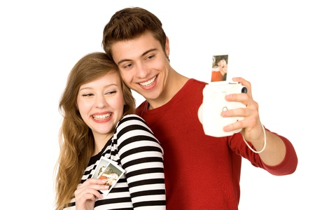taking picture: Young couple with instant camera
