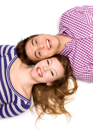 Young couple lying head to head photo
