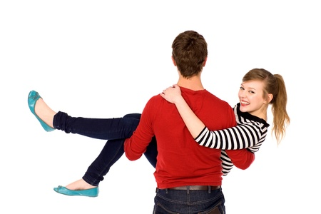 carrying girlfriend: Man carrying his girlfriend in his arms