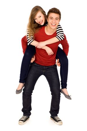 Young man giving woman a piggyback photo
