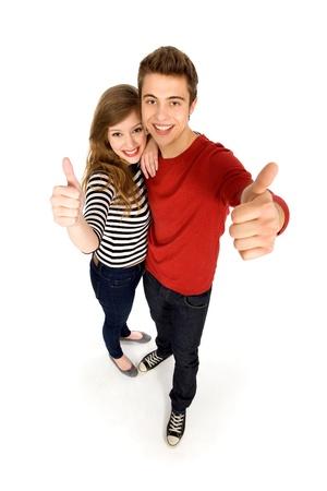 pareja de adolescentes: Par mostrar pulgares  Foto de archivo