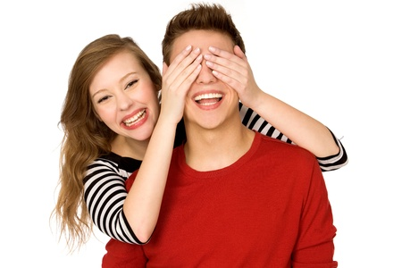 hand covering eye: Woman covering boyfriend's eyes
