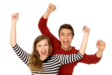 excited people: Couple with arms raised