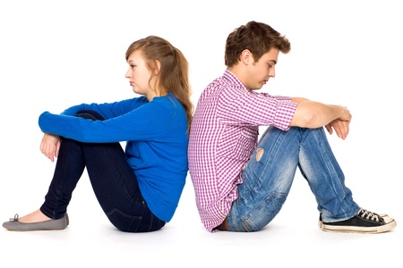 difficulties: Teenage couple sitting back to back