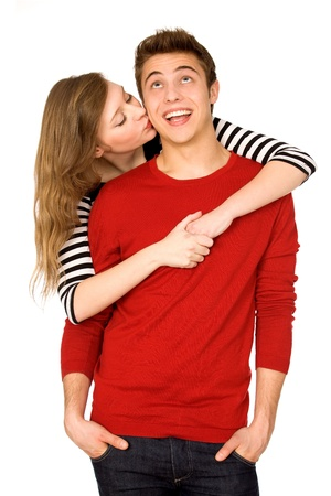 young couple hugging kissing: Surprise kiss Stock Photo
