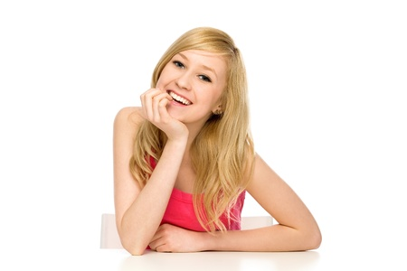Girl leaning on table Stock Photo - 10038147