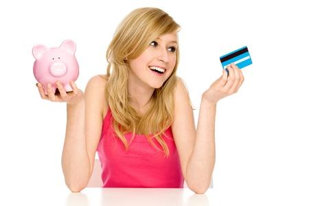 spending money: Piggy bank or credit card