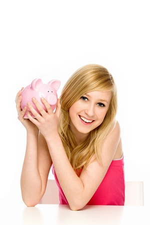white piggy bank: Young Woman Holding Piggy Bank