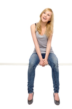 people sitting: Young woman sitting Stock Photo