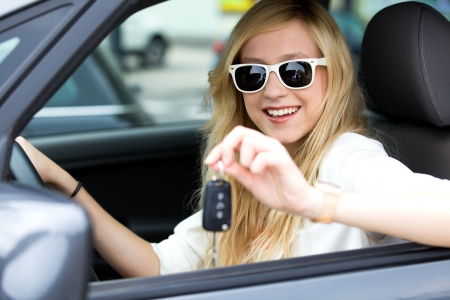 car driver: Smiling Woman Showing off New Car Keys
