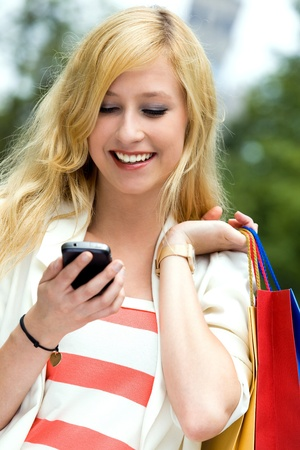 mobile shopping: Teenage girl looking at mobile phone