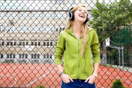 Teenage girl leaning on fence photo