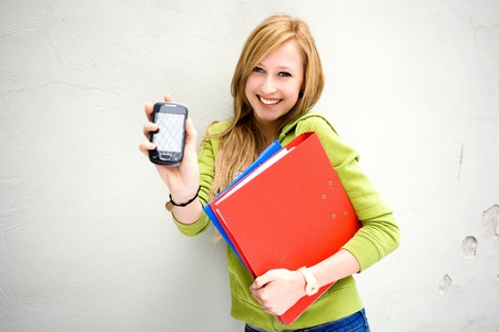 teenagers standing: Female student with mobile phone Stock Photo