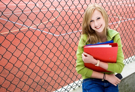 school yard: Student with her books Stock Photo
