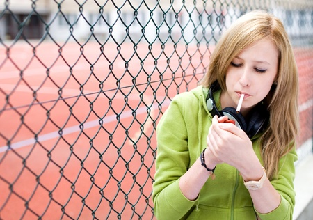 rebellion: Teenage girl smoking Stock Photo