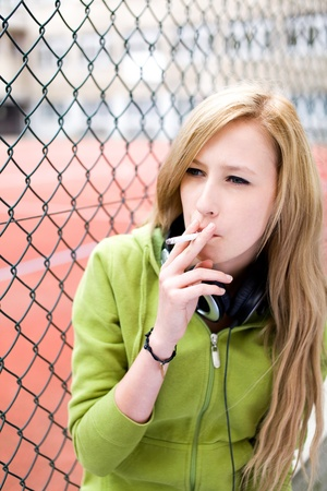 fag: Teenage girl smoking Stock Photo