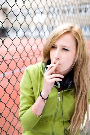 smoking: Teenage girl smoking Stock Photo