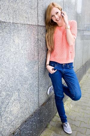 Teenage girl with mobile phone photo
