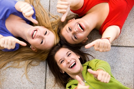 Teens With Thumbs Up Stock Photo - 10385674