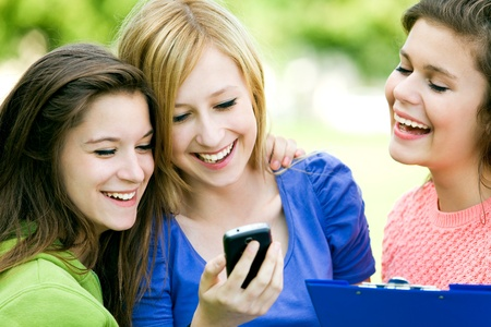 Three girls looking at mobile phone photo