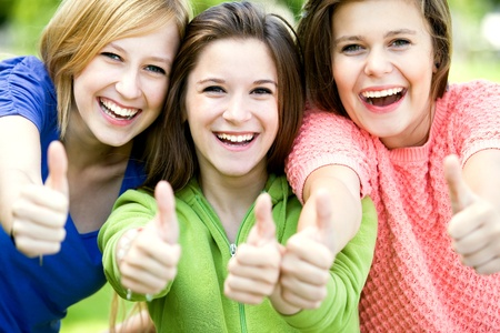 Friends with thumbs up Stock Photo - 10385689