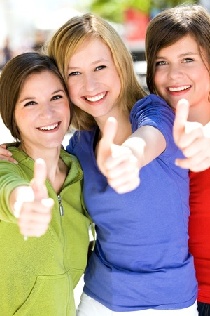 Friends showing thumbs up sign Stock Photo - 10427456
