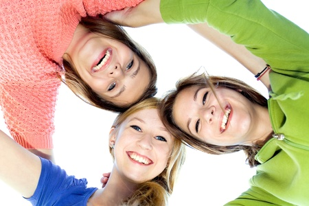 Three girls in a huddle Stock Photo - 10427453