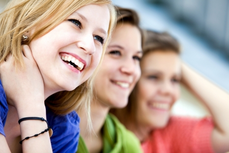 people laughing: Happy young friends Stock Photo