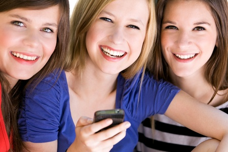 Teens with mobile phone Stock Photo - 10427457