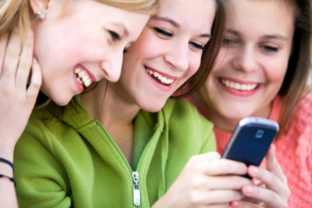 Teens with mobile phone photo
