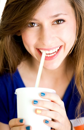 a straw: Girl drinking soda
