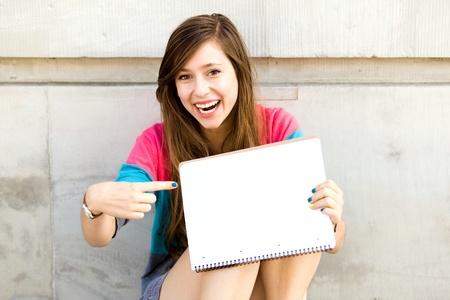 Teenage girl pointing finger photo