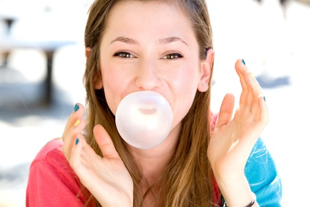 chewing gum: Young girl blowing bubble gum Stock Photo
