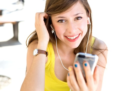 teenage girl happy: Girl with mp3 player