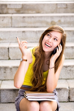 teenagers laughing: Girl sitting on stairs