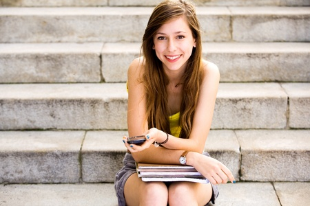 young teen girl: Girl sitting on stairs