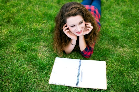 learning by doing: Girl studying outdoors