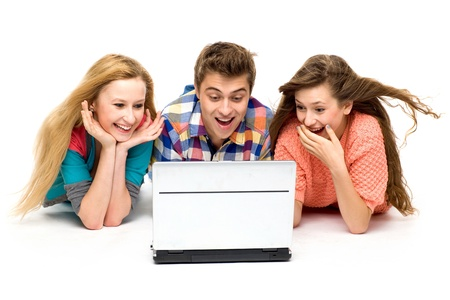 woman looking down: Amazed young people with laptop