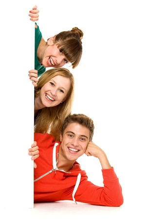 Friends holding blank poster Stock Photo - 10663717