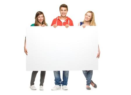 estudiantes: Amigos la celebraci�n de cartel en blanco Foto de archivo
